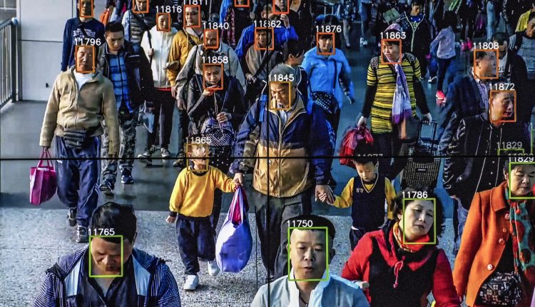 Monitors display a video showing facial recognition software in use at the headquarters of the artificial intelligence company Megvii, in Beijing.