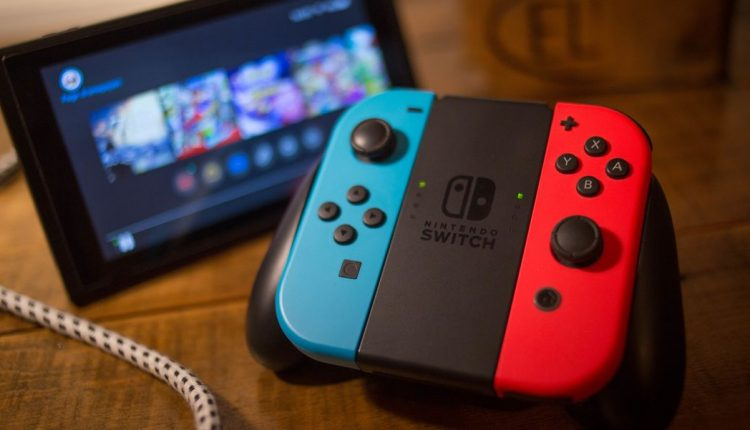 in-this-photo-illustration-a-nintendo-switch-seen-with-the-news-photo-1589468722